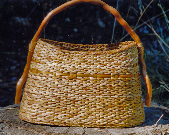 2004 – Entwined Vessel with Root Handle has won the Handweavers Guild of America Award at Convergence 2004 in Denver, Colorado!